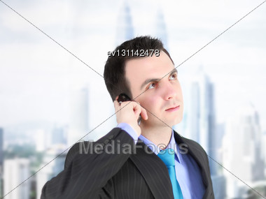 European Businessman With Cell Phone. Isolated Over White Stock Photo