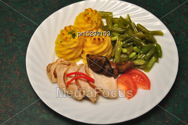 Evening Meal Of Mashed Potato, Beans, Roast Chicken Breasts, Mushrooms And Tomato Stock Photo