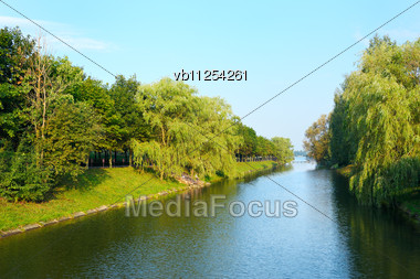 Evening In The Park, The Trees Above The River Near The Lake Stock Photo