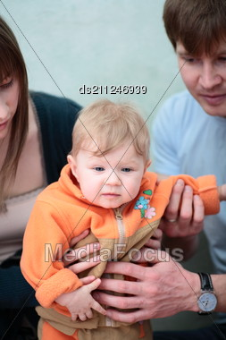 Excited Happy Young Family Of Three Person Stock Photo