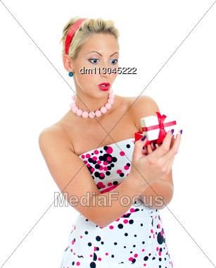 Excited Woman Holding A Gift . Isolated On White. Stock Photo