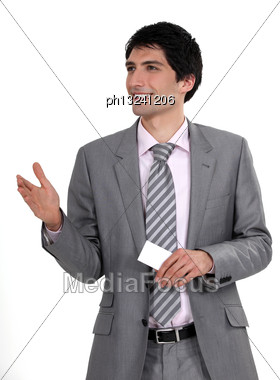 Executive Offering A Handshake And Business Card Stock Photo