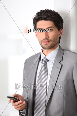 Executive With Mobile Phone Stock Photo