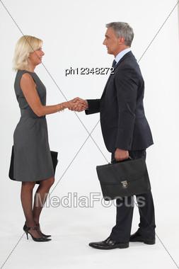 Executives Shaking Hands Stock Photo