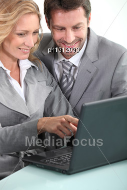 Executives With Laptop Computer Stock Photo