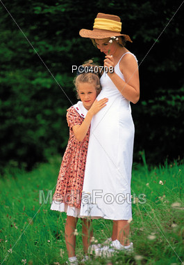 Expecting Mother with Daughter Stock Photo