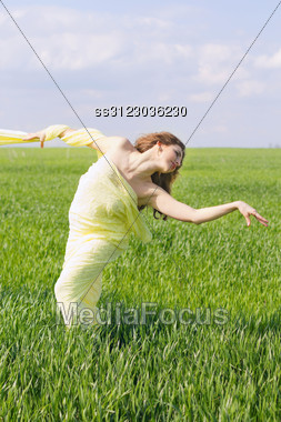 Expressive Charming Young Woman Wrapped In Yellow Cloth Stock Photo