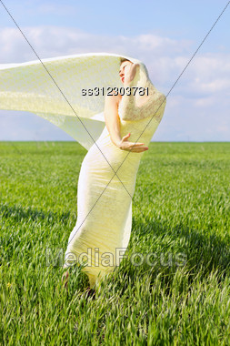 Expressive Cute Young Woman Wrapped In Yellow Cloth Stock Photo