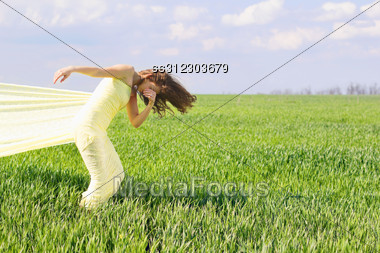 Expressive Flexible Young Woman Wrapped In Yellow Cloth Stock Photo