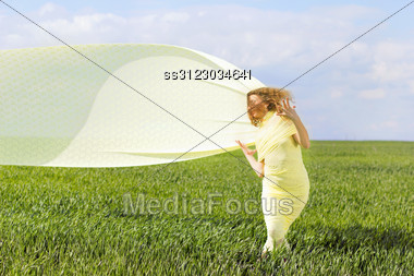 Expressive Gorgeous Young Woman Wrapped In Yellow Cloth Stock Photo