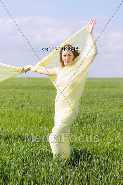 Expressive Nice Young Woman Wrapped In Yellow Cloth Stock Photo
