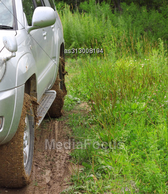 Extreme Offroad Behind An Unrecognizable Car In Mud Stock Photo