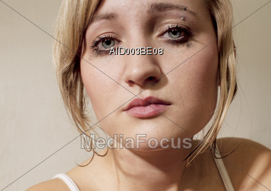 Face of a Sad Young Woman Stock Photo