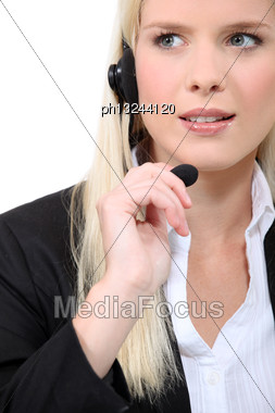 Fair-haired Woman With Earphones Stock Photo