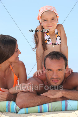 Family Enjoying A Day Out At The Beach Stock Photo