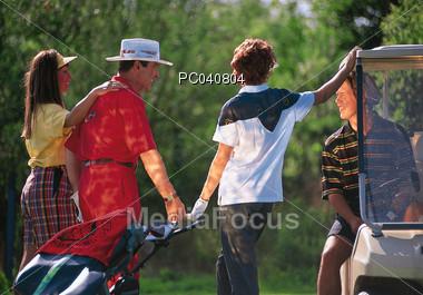 Family Golfing Stock Photo