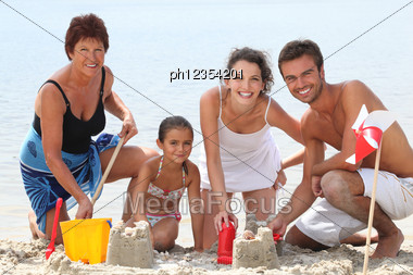 Family Having Fun At The Beach Stock Photo