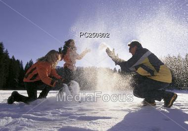 Family Having Snowball Fight Stock Photo