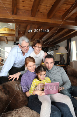 Family In Front Of A Computer Stock Photo