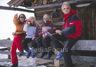 Family in Front of Log Cabin Stock Photo