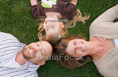Family Laying in the Grass Stock Photo
