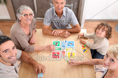 Family Playing Board Games. Stock Photo