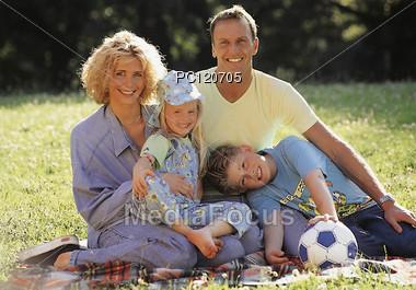 Family Resting in Park Stock Photo