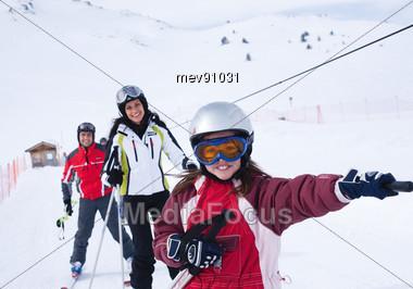 Family Skiing - on The Ski Lift Stock Photo