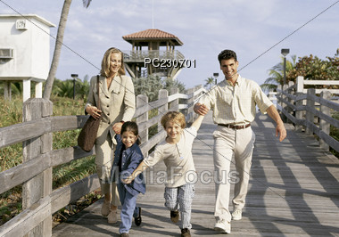 Family Walking on Boardwalk Stock Photo