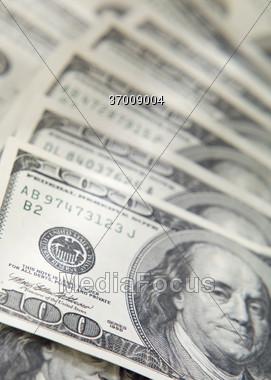 Fanned 100 Dollar Bills Stock Photo