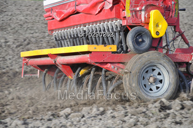 Farmer Drilling Seed Into Pasture Paddock, Westland, New Zealand Stock Photo