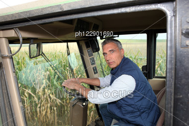 Farmer Driving A Tractor Stock Photo