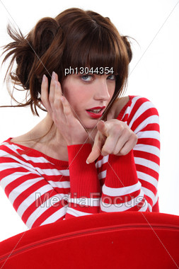 Fashionable Woman Pointing Her Finger Stock Photo