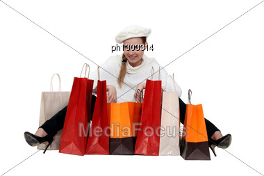 Fashionable Woman Surrounded By Her Shopping Bags Stock Photo