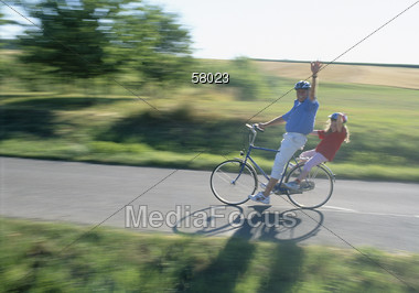Father and Daughter Biking Stock Photo