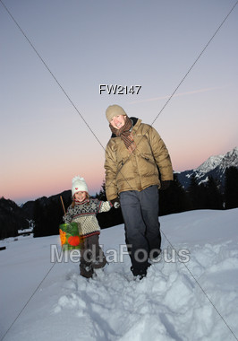 Father and Daughter Walking Thru Snow Stock Photo