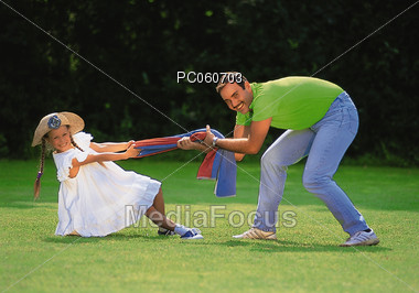 Father and Dauther Playing Outdoors Stock Photo