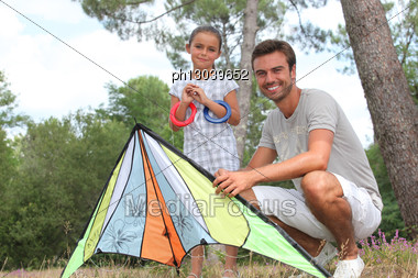 Father And His Daughter With A Kite Stock Photo