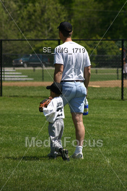 Father and son at baseball field Stock Photo