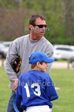 Father and Son at Baseball Game Stock Photo
