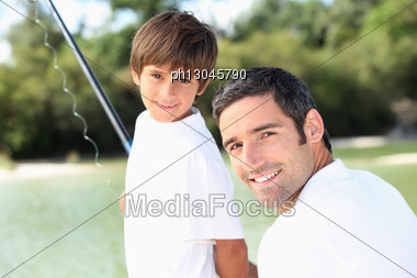 Father And Son Fishing Together Stock Photo