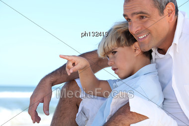 Father And Son On A Beach Stock Photo
