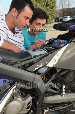 Father And Son With Motorcycle Stock Photo