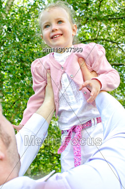Father And Daughter Having Fun In The Park Stock Photo
