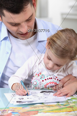 Father Drawing With Daughter Stock Photo