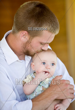 Father Kissing Son Stock Photo