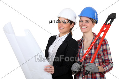 Female Architect And Builder Stock Photo