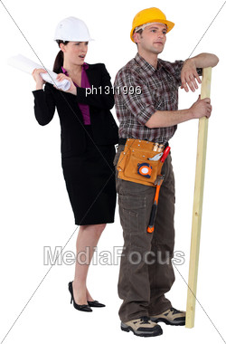 Female Architect And Male Carpenter Stock Photo