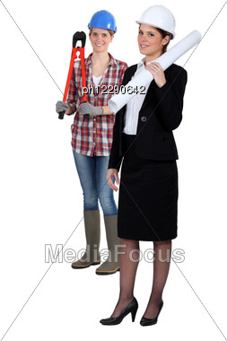 Female Architect And Manual Worker Stock Photo