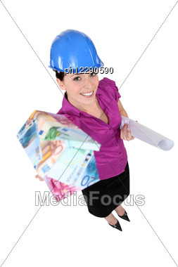 Female Architect Presenting House Stock Photo
